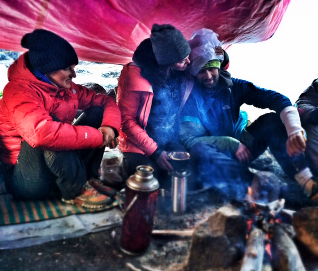 The team rests after attempting the summit of Hkakabo Razi. One of the team members sports a fractured arm. Photo credit: Hilaree O'Neill