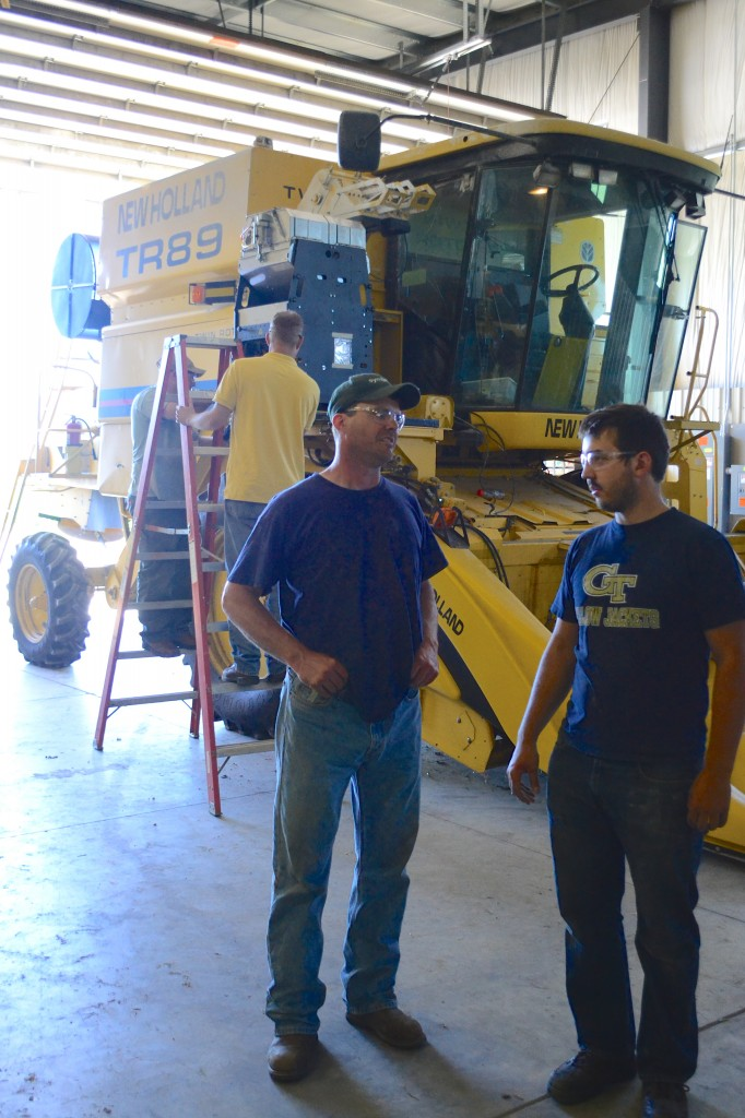 Matt, a HarvestMaster engineer, speaks with one of the customers' research associates about the new H2 GrainGages being installed.