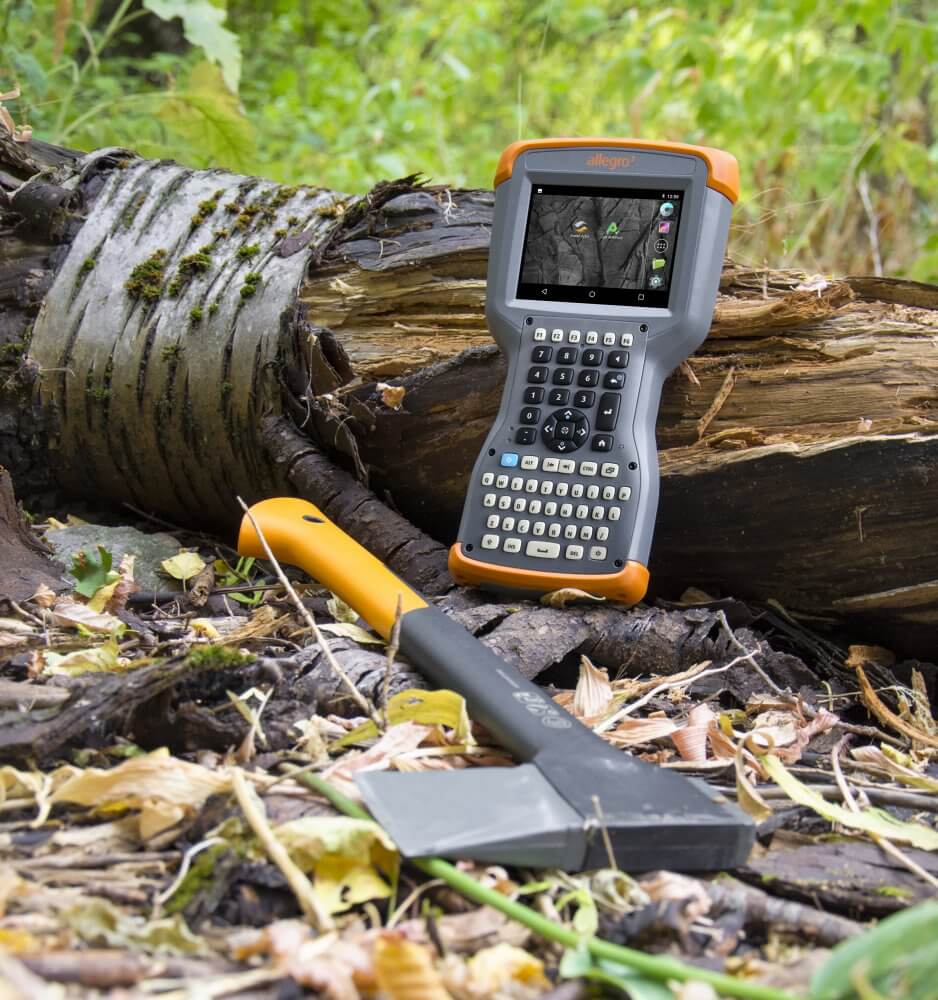 Allegro 3 Rugged Mobile Computer being used in the extreme heat of the forest.