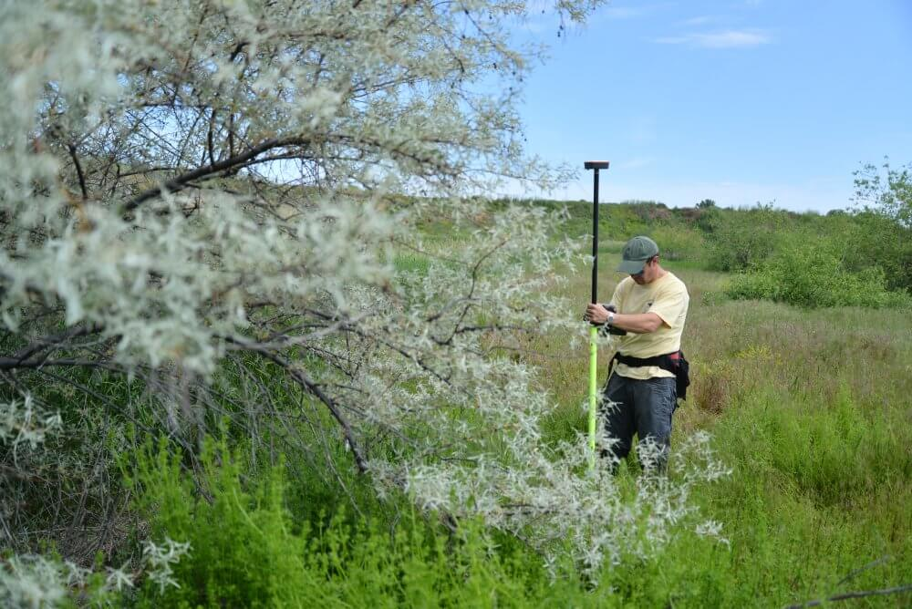Using the Juniper Survey Pole to avoid obstacles and have the GPS receiver clear of the body.