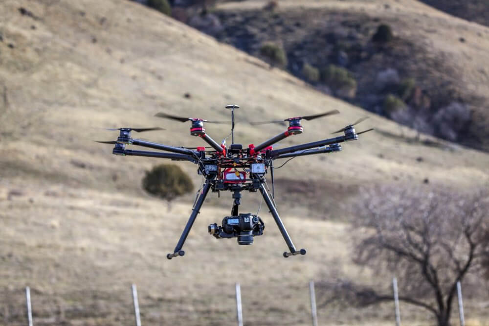 The Utah State University Remote Sensing/GIS Laboratory's DJI s1000 sUAS on landing approach near Logan, Utah, Feb. 2015.